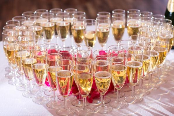 champaign glasses heart catered wedding