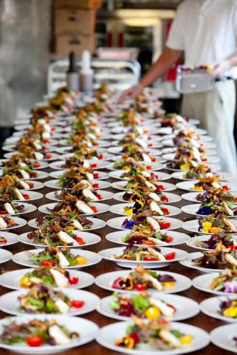 long table of appetizer plates