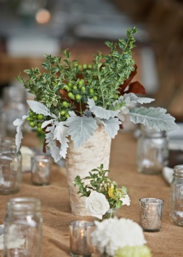 white vase with greenery on wedding table