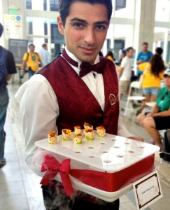 catering waiter presenting appetizers