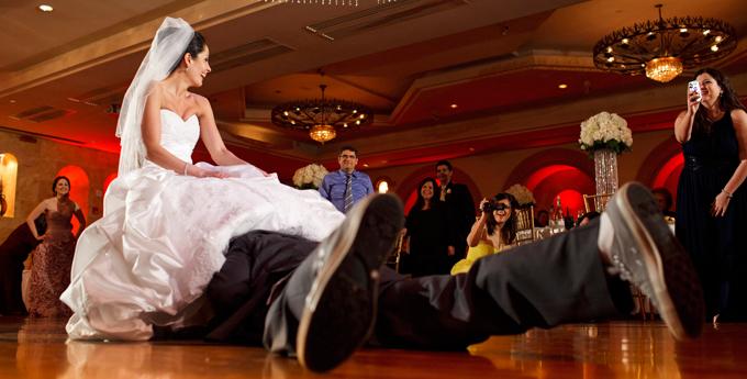 Removing the brides garter.